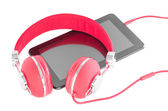 Bright red headphones and black tablet pc — Stock Photo