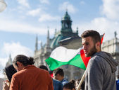 Face of a young activist on the background of the Palestinian fl — Stock Photo
