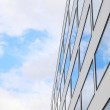 Blue sky and clouds reflected windows of modern building — Stock Photo #51431995
