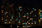 Night colorful windows lights in residential building — Stock Photo