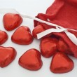 Chocolate Hearts come out of a Christmas stocking - Foto Stock