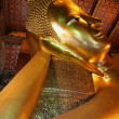 Reclining Buddha. Wat Pho temple. Bangkok. Thailand. - Stock Photo