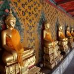 Ancient buddha images. Wat Arun temple. Bangkok. Thailand. — Stock Photo #14793993
