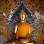 Ancient buddha images. Wat Arun temple. Bangkok. Thailand. — Stock Photo #14794031