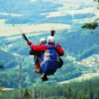 Stock Photo: Tandem paragliding