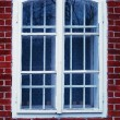 Old white window with bricks — Stock Photo