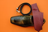 Business Man's Attire: Maroon Tie, Black Belt and Shoe — Stock Photo