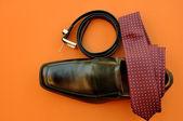 Business Man's Attire: Maroon Tie, Black Belt and Shoe — Stock Photo