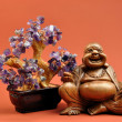 Laughing Buddha Statue with Healing Amethyst Crystal Tree — Stock Photo #14836275