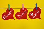 Colorful Hanging Happy New Year Heart Message — Stock Photo