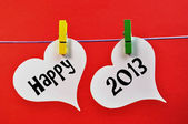 Happy New Year 2013 Message on Pegs Hanging Hearts — Stock Photo