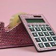 Pink Bling Office Accessories Adhesive Tape Dispenser and Calculator - Stock Photo