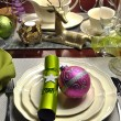 Christmas Eve Pink & Green Dinner Table Setting - Stock Photo