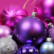 Pink and Purple Christmas Bauble Decorations - Stock Photo