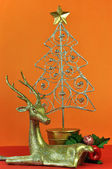 Gold and Silver Reindeer and Christmas Tree — Stock Photo