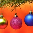 Stock Photo: Pink Blue and Green Baubles Hanging from Tree