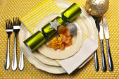 Yellow Christmas Holiday Table Setting on Gingham Tablemat — Stock Photo