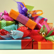 Stack of Bright Color Present Festive Holiday Gifts — Stock Photo #16330721