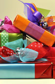 Stack of Bright Color Present Festive Holiday Gifts (vertical) — Stock Photo