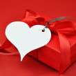 Romantic Red Present with White Heart Gift Tag — Stock Photo