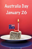 Australia Day Lamington Cake, flag and candle with text. — Stock Photo