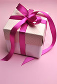 Beautiful pink present gift with polka dots and bright candy fuchsia pink bow — Stock Photo
