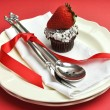 Red theme dining table setting with silver cutlery — Stock Photo