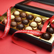 Valentine romantic opened box of chocolates. — Stock Photo