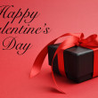Happy Valentine's Day message with red and black present — Stock Photo