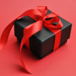 Beautiful red and black Valentine present (close up) — Stock Photo #17660359