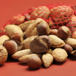 Healthy Food - Nuts on a Terra-cotta Background with Shallow DOf — Stock Photo