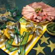 Green, Gold and White Party Table Celebrations with Party Food. — Stock Photo