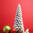 White Christmas tree candle and green and red glitter baubles still life — Foto Stock