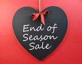 """End of Season Sale"" sign message on heart blackboard against a red background. — Stock Photo"