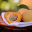 Fresh apricots on plate closeup - Stock fotografie