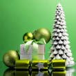 Green theme Christmas tree, gift and baubles festive holiday still life. — Stock Photo