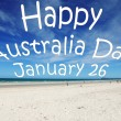 """Happy AustraliDay January 26"" message written over white sandy Australibeach. — Stock Photo #18439933"