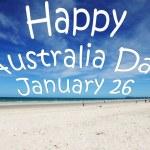 """Happy Australia Day January 26"" message written over white sandy Australian beach. — Stock Photo"