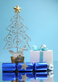 Blue theme Christmas tree, gift and baubles festive holiday still life. — Stock Photo