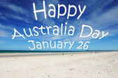 """Happy Australia Day January 26"" message written over white sandy Australian beach. — Stock Photo"