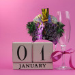 Stock Photo: Pink theme Happy New Year, January 1, block calendar.