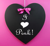 "Pink Ribbon theme ""I Heart Pink"" message written on a heart shape blackboard — Stock Photo"