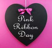 """""""Pink Ribbon Day"""" message written on a heart shape blackboard — Stockfoto"""