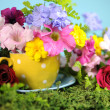 Beautiful Springtime bright colorful Spring flowers and polka dot cup. Close-up. — Stock Photo