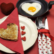 Red theme Valentine breakfast with heart shape egg and toast with love hearts — Stock Photo