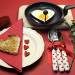 Red theme Valentine breakfast with heart shape egg and toast with love hearts - Stock Photo