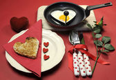 Red theme Valentine breakfast with heart shape egg and toast with love hearts — ストック写真