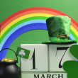 Stock Photo: St Patrick's Day calendar date, March 17, with Leprechaun hat, pot of gold, and rainbow