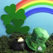 St Patrick's Day still life with leprechaun hat, pot of gold, shamrocks and rainbow — Stock Photo