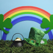 Stock Photo: St Patrick's Day still life with leprechaun hat, pot of gold, shamrocks and rainbow